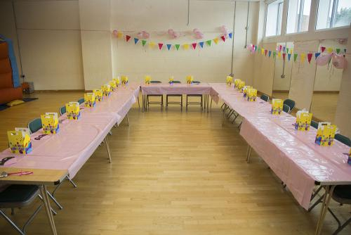 Kids party larger hall U-shaped table layout